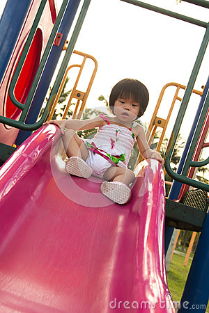 Child on a slide in playground