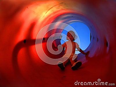 Child in Slide Tube
