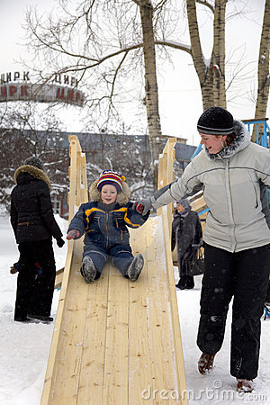Child slide on winter playground