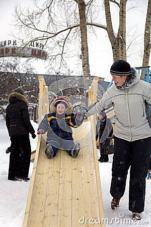 Child slide on winter playground
