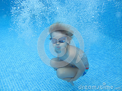 The child smile underwater