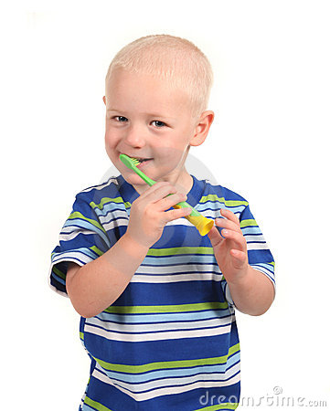 Child Smiling and Brushing His Teeth