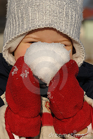 Child with snow ball