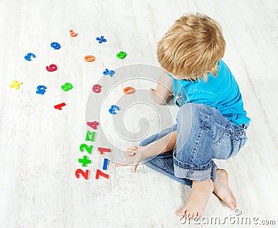Child solve the mathematics example. Test