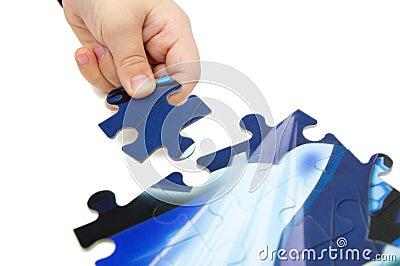 Child solving puzzle