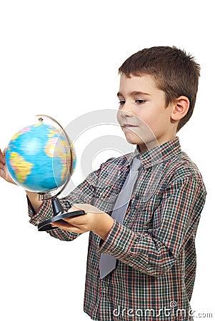 Child spin a globe
