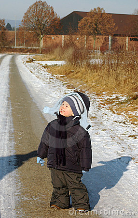 Child stand  on the road.