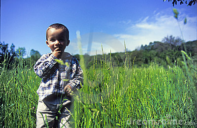 Child standing in grass