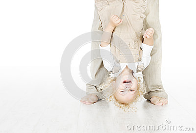 Child standing head over heels.