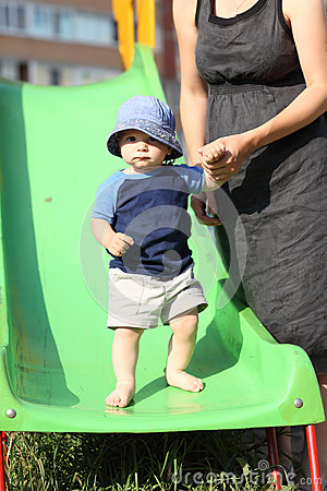 Child standing on slide