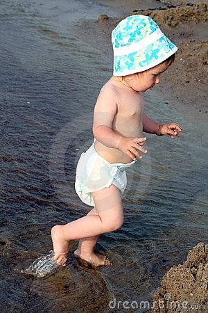 Child steps into the sea