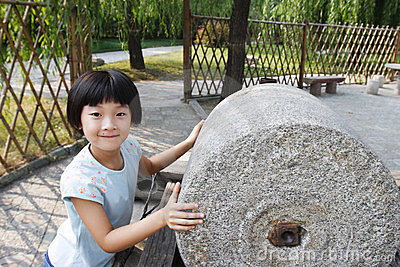 Child with stone roller