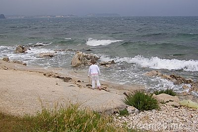 Child on stormy beach