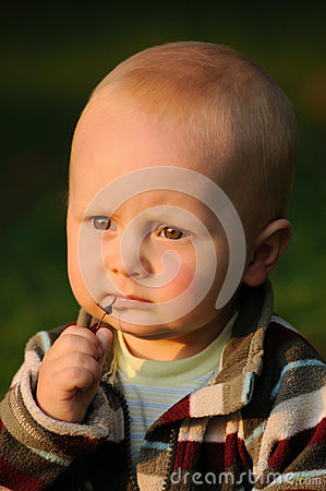 Child with straw in mouth