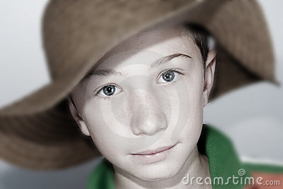 child with straws hat