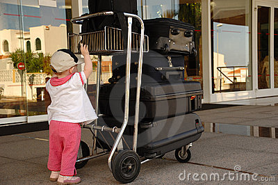 Child and suitcases