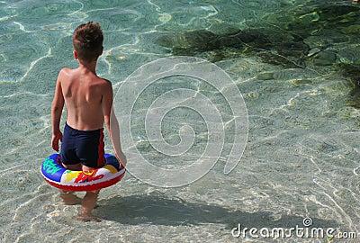 Child with swimming belt