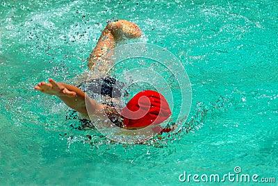 Child swimming freestyle