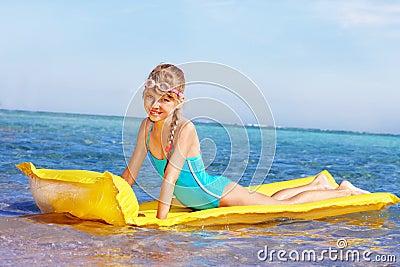 Child swimming inflatable beach mattress.