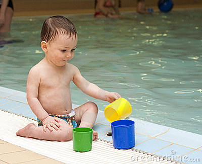 Child by swimming pool