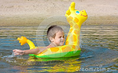 Child swims in the river
