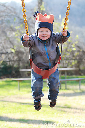 Child on Swing at a Playground