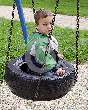 Child on swing at playground