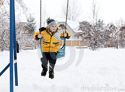 Child on a swing in the winter