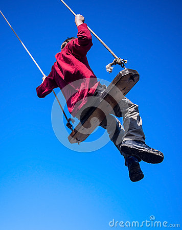 Child swinging on swing