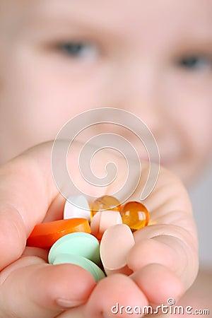 Child takes vitamins