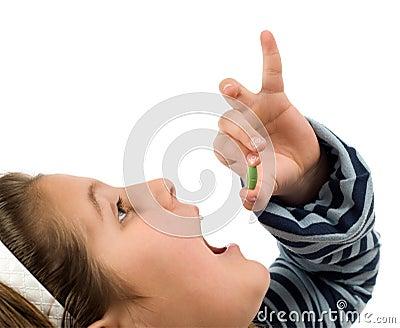 Child Taking Pill