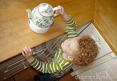 Child taking Teapot