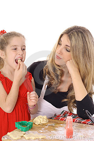 Child tasting cookie batter
