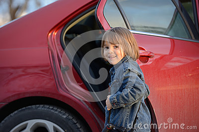 Child about to get into car