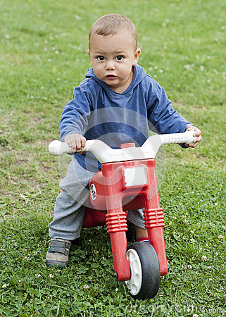 Child with toy bike