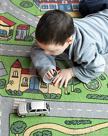 Child with toy car