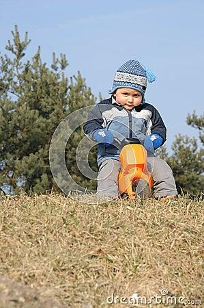 Child on toy motorbike