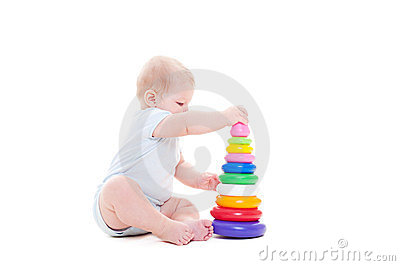 Child with toy over white