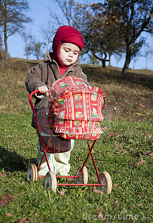 Child with a toy pram