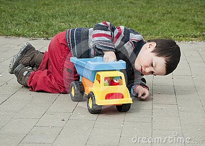 Child with toy truck