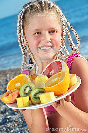 Child with tropical fruit