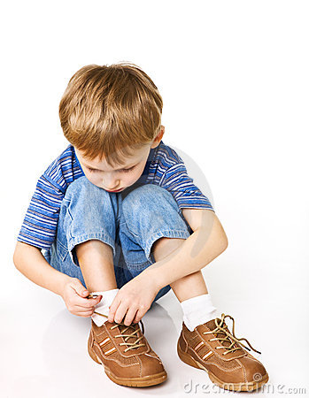 Free Child Try To Tie Shoelaces Stock Photos - 6539653
