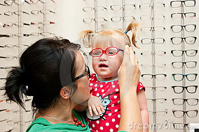 Child trying on eyeglasses