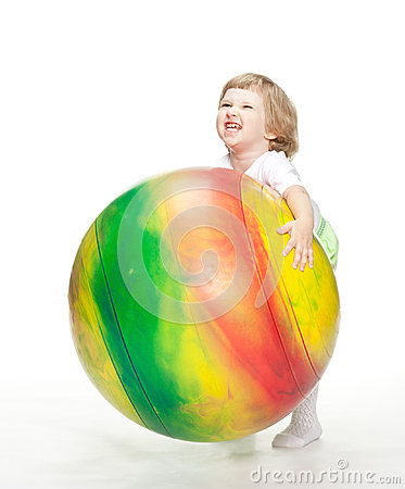 Child trying to carry huge fitball