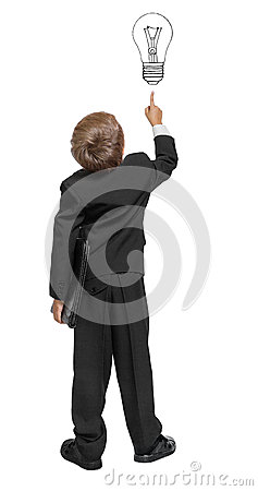 Child  in a tuxedo pointing at wall.