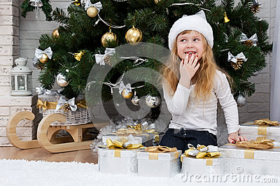 Child under the Christmas tree