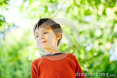 Child under leaves