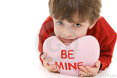 Child with Valentine pillow