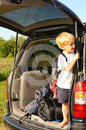 Child Waiting in Van to Leave for Vacation