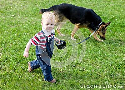 Child walking dog